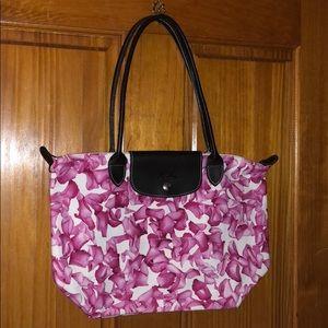 Longchamp pink floral print bag.